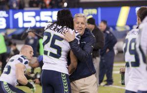 Richard_Sherman_and_Pete_Carroll_in_embrace_Super_Bowl_XLVIII