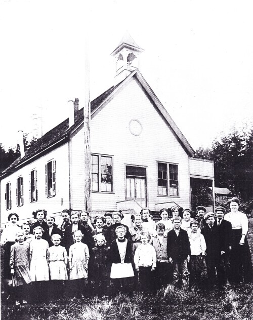 "From the Skagit Valley Historical Museum. Pleasant Ridge School About 1911 or 1912. This is a larger version of the picture above. A second page listed the names of everyone in the picture in shaky script with the note ""original from Grace Talin."""
