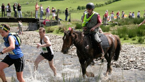 Man versus horse. From the World Alternative Games website.